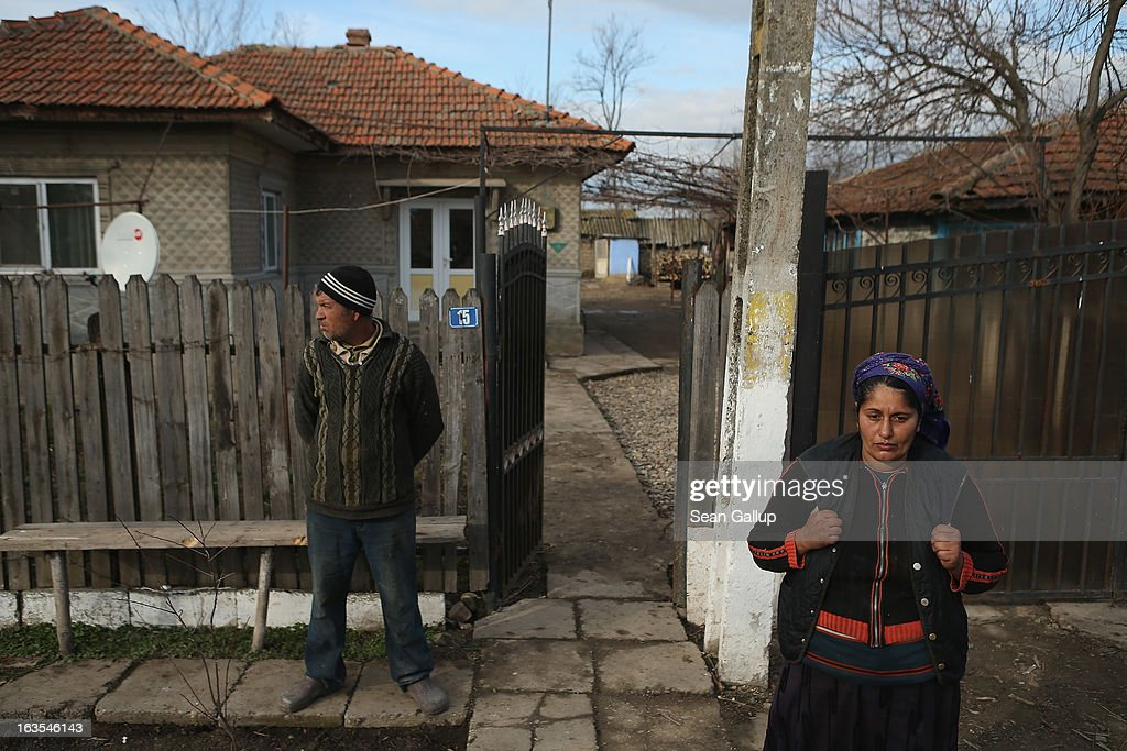 Ethnic Roma Vasile and Valentina Ilie stand outside their home on March 11, 2013 in Dilga, Romania. Dilga is a settlement of 2,500 people with dirt roads and no running water, and unemployment is at 70%. Most of the working-age men and women have at some point worked abroad, mostly in Italy or Great Britain, as many say they are unable to find adequate work in Romania. Romania's Roma belong to a myriad of different tribes defined by their craft, and Dilga's belong to a group called the Rudari, who until the 1930s specialised in woodcrafts. During the communist years most worked in nearby state-run factories and agricultural cooperatives, though the majority of these went bankrupt after 1989 and the local Roma lost their jobs. Since then they have struggled to make ends meet and find a better future for their children, though projects initiated by the European Union and NGOs are helping some to launch small-scale enterprises and improve their children's education.