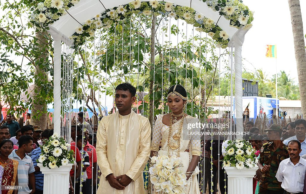 Ethnic Sinhalese J H N Rathnayake and former Tamil rebel P Sugandini get married in the northern Sri Lanan town of Kilinochchi Sept 18 at a ceremony...