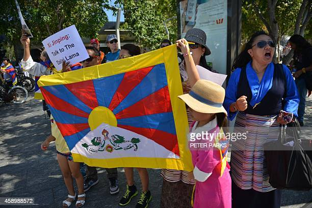 Ethnic Tibetan protesters hold up placards and chant slogans demanding G20 leaders to hear the plight of the Tibetan people on the first day of the...