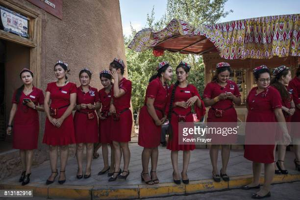 Ethnic Uyghur tourists guides wait to perform in a show for Chinese tourists on June 29 2017 in the old town of Kashgar in the far western Xinjiang...