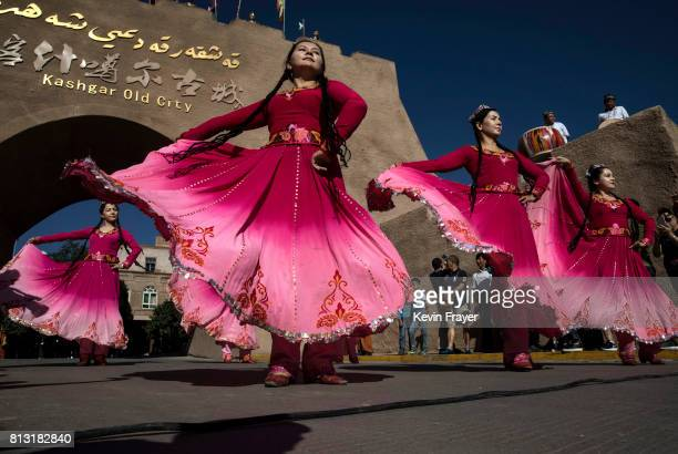 Ethnic Uyghur women dance for Chinese tourists on June 29 2017 in the old town of Kashgar in the far western Xinjiang province China Kashgar has long...
