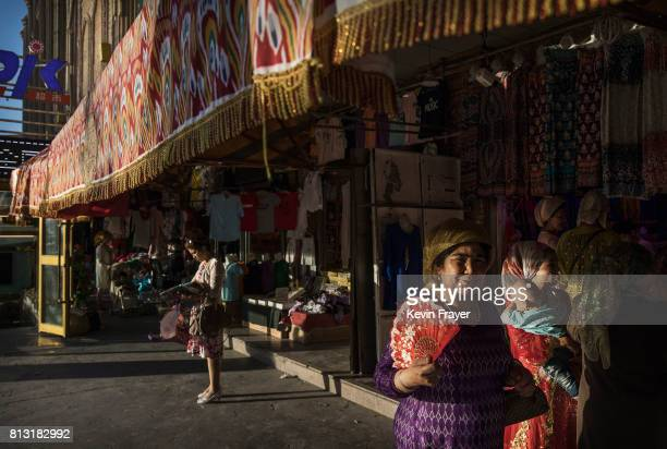 Ethnic Uyghur women shop in a market on June 29 2017 in the old town of Kashgar in the far western Xinjiang province China Kashgar has long been...