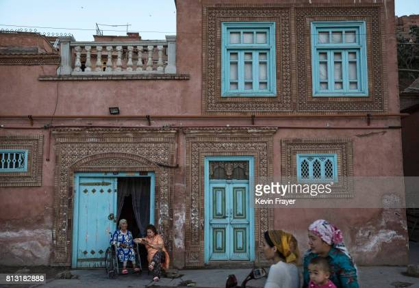 Ethnic Uyghur women sit outside their home on June 30 2017 in the old town of Kashgar in the far western Xinjiang province China Kashgar has long...