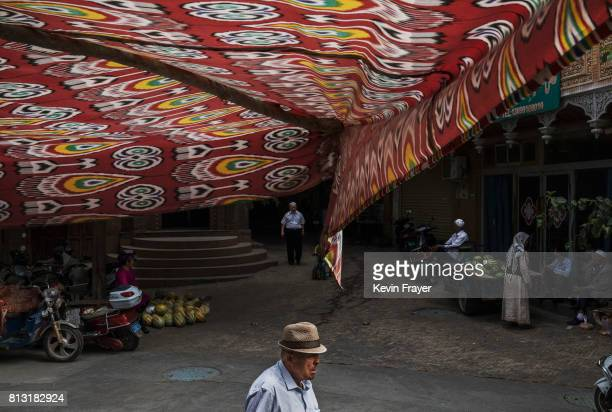 Ethnic Uyghurs are seen in the street on July 1 2017 in the old town of Kashgar in the far western Xinjiang province China Kashgar has long been...