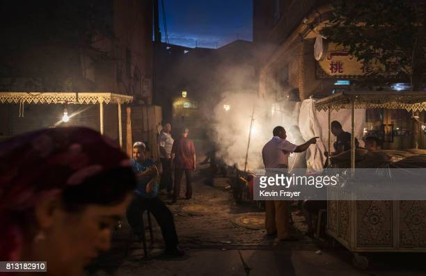 Ethnic Uyghurs gather in a local food market on June 26 2017 in the old town of Kashgar in the far western Xinjiang province China Kashgar has long...