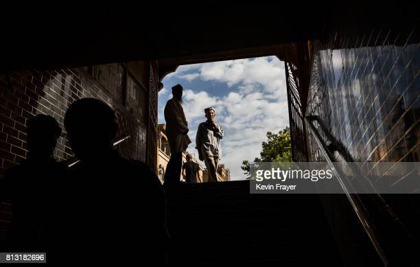 Ethnic Uyghurs walk in an underpass on June 27 2017 in the old town of Kashgar in the far western Xinjiang province China Kashgar has long been...