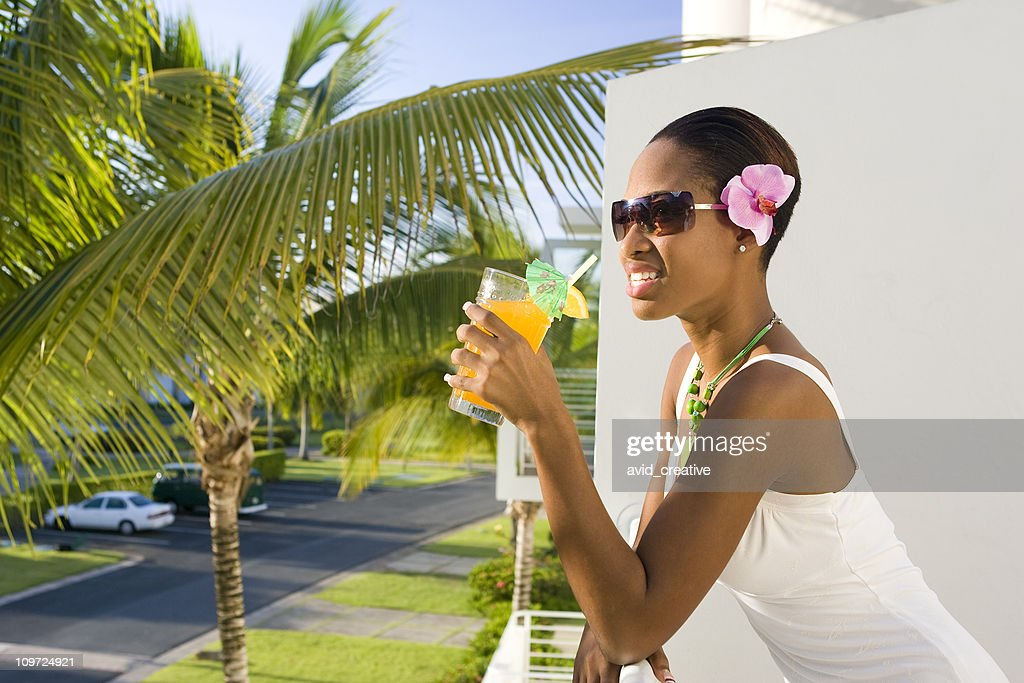 Ethnic Woman Relaxing with Drink in Hand : Stock Photo
