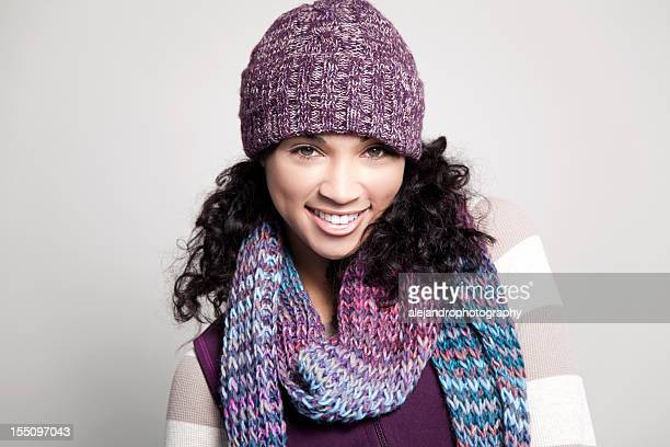Ethnic woman with hat smiling