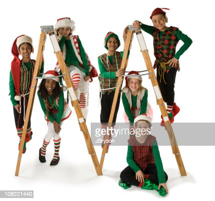 Ethnically Diverse Group of Christmas Elves on Ladders