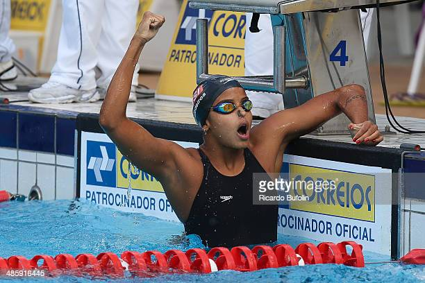 Etiene Medeiros celebrates the victory in the 100m backstroke qualifying on day one of the Maria Lenk Swimming Trophy 2014 at Ibirapuera Sports...