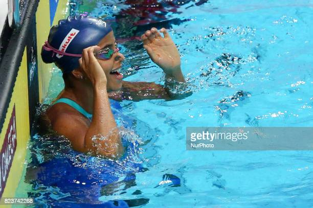Etiene Medeiros competes and celebrates heir gold medal on Women's 50 m Backstrokefinal during the 17th FINA World Championships at Duna Arena in...
