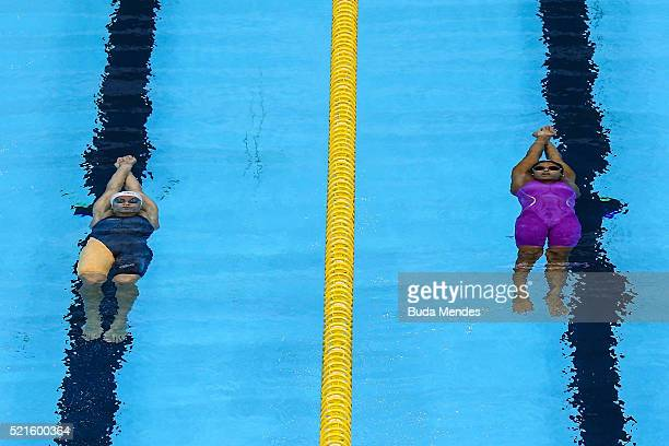 Etiene Medeiros of Brazil and Katarina Listopadova of Slovakia swim the Women's 100m Backstroke Final during the Maria Lenk Trophy competition at the...