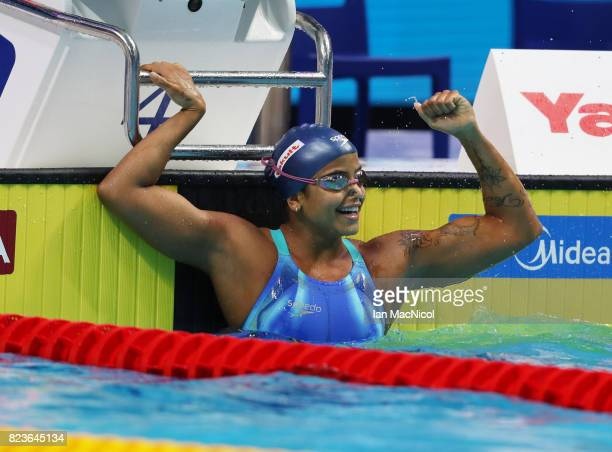 Etiene Medeiros of Brazil celebrates after she wins 50m Backstroke final on day fourteen of the FINA World Championships at the Duna Arena on July 27...