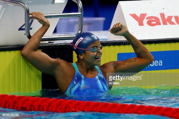 Etiene Medeiros of Brazil celebrates after winning the gold medal during the Women's 50m Backstroke final on day fourteen of the Budapest 2017 FINA...