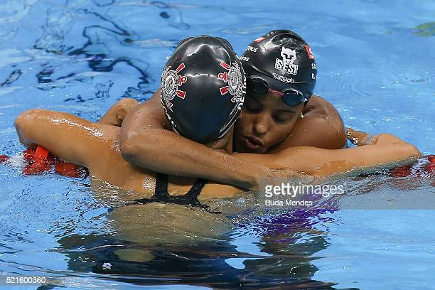 Etiene Medeiros of Brazil celebrates after winning the Women's 100m Backstroke Final during the Maria Lenk Trophy competition at the Aquece Rio Test...