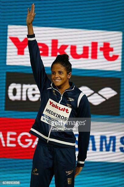 Etiene Medeiros of Brazil celebrates her gold medal in the 50m Backstroke on day five of the 13th FINA World Swimming Championships at the WFCU...