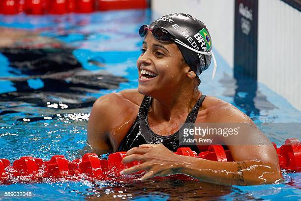Etiene Medeiros of Brazil reacts after the first Semifinal of the Women's 50m Freestyle on Day 7 of the Rio 2016 Olympic Games at the Olympic...