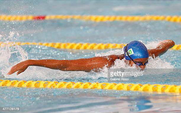 Etiene Pires De Medeiros of Brazil competes during the womens 100m butterfly heats during day one of the X South American Games Santiago 2014 at...