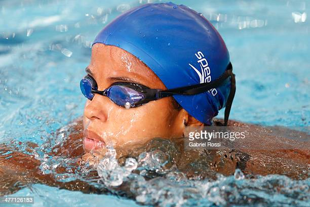 Etiene Pires De Medeiros of Brazil looks on after finish the womens 100m butterfly heats during day one of the X South American Games Santiago 2014...