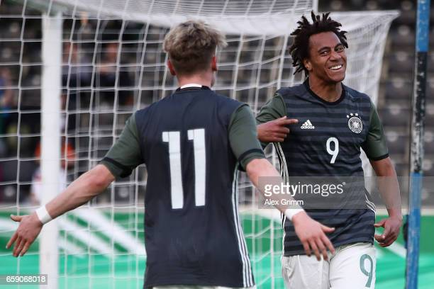 Etienne Amenyido of Germany celebrates his team's third goal with team mate Robin Hack during the UEFA Elite Round match between Germany U19 and...