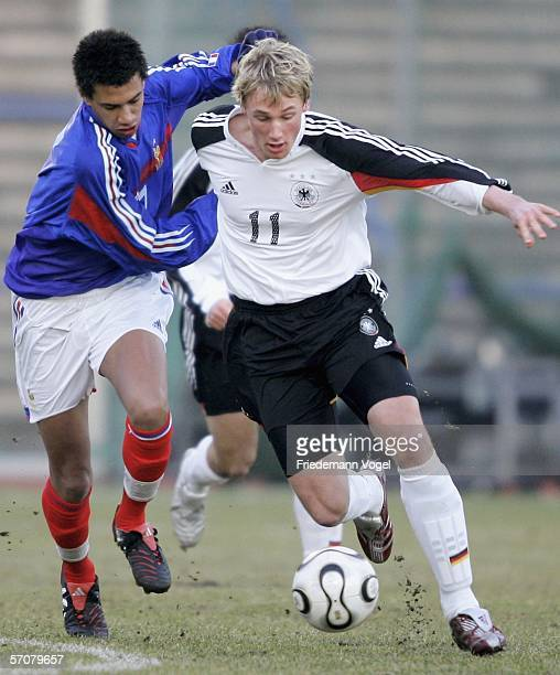 Etienne Capoue of France challenges for the ball with Felix Bastians of Germany during the friendly match between Germany U18's and France U18's at...
