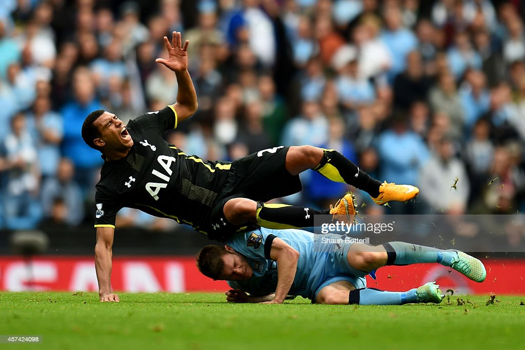 <a gi-track='captionPersonalityLinkClicked' href=/galleries/search?phrase=Etienne+Capoue&family=editorial&specificpeople=809639 ng-click='$event.stopPropagation()'>Etienne Capoue</a> of Spurs is tackled by <a gi-track='captionPersonalityLinkClicked' href=/galleries/search?phrase=James+Milner&family=editorial&specificpeople=214576 ng-click='$event.stopPropagation()'>James Milner</a> of Manchester City during the Barclays Premier League match between Manchester City and Tottenham Hotspur at Etihad Stadium on October 18, 2014 in Manchester, England.