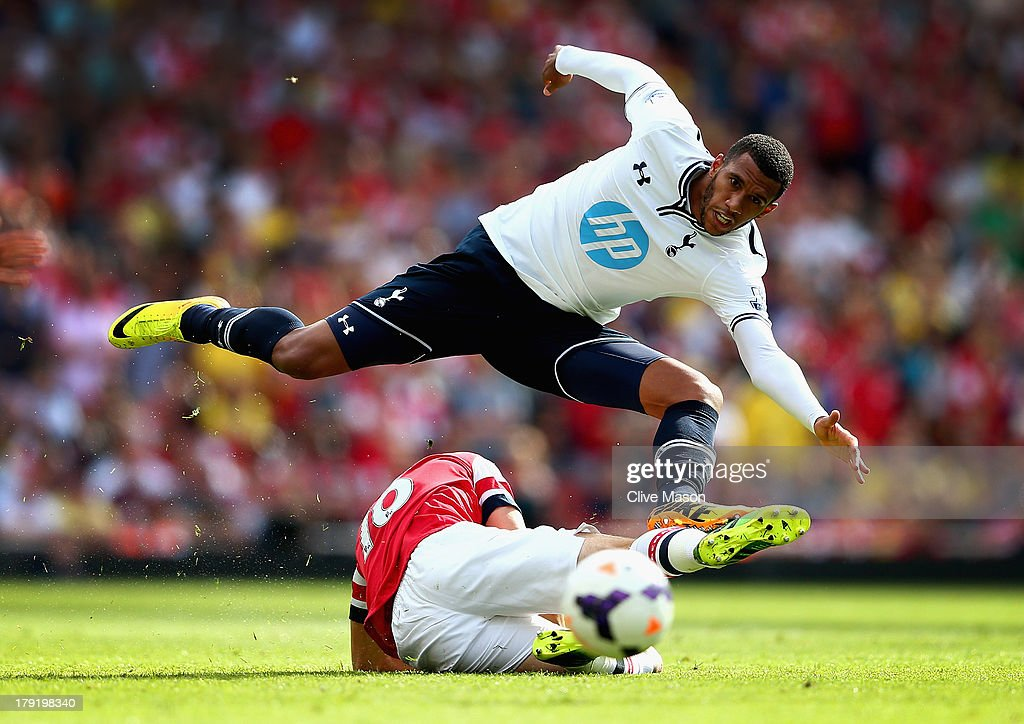 <a gi-track='captionPersonalityLinkClicked' href=/galleries/search?phrase=Etienne+Capoue&family=editorial&specificpeople=809639 ng-click='$event.stopPropagation()'>Etienne Capoue</a> of Spurs leaps over a challenge from <a gi-track='captionPersonalityLinkClicked' href=/galleries/search?phrase=Aaron+Ramsey+-+Soccer+Player&family=editorial&specificpeople=4784114 ng-click='$event.stopPropagation()'>Aaron Ramsey</a> of Arsenal during the Barclays Premier League match between Arsenal and Tottenham Hotspur at Emirates Stadium on September 01, 2013 in London, England.