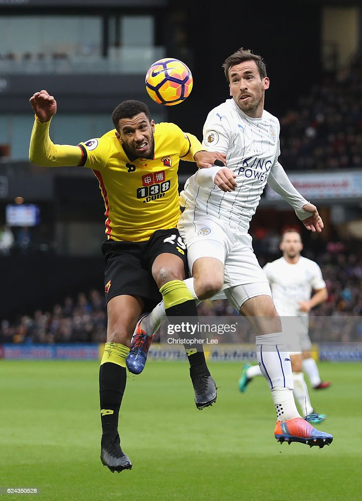 Etienne Capoue of Watford (L) and Christian Fuchs of Leicester City (R) battle for possession in the air during the Premier League match between Watford and Leicester City at Vicarage Road on November 19, 2016 in Watford, England.