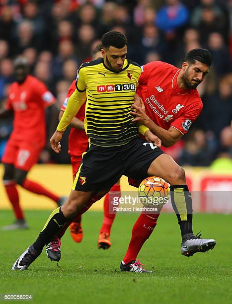 Etienne Capoue of Watford holds off Emre Can of Liverpool during the Barclays Premier League match between Watford and Liverpool at Vicarage Road on...