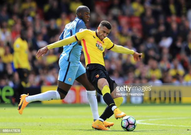 Etienne Capoue of Watford holds off Yaya Toure of Manchester City during the Premier League match between Watford and Manchester City at Vicarage...
