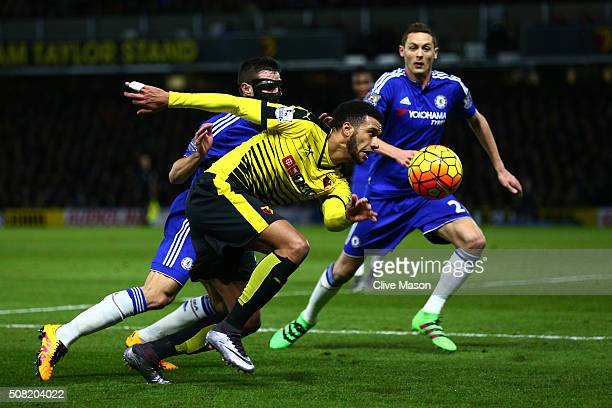 Etienne Capoue of Watford is challenged by Cesar Azpilicueta of Chelsea during the Barclays Premier League match between Watford and Chelsea at...