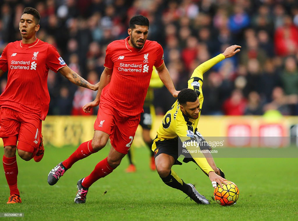 Etienne Capoue of Watford is challenged by Emre Can of Liverpool during the Barclays Premier League match between Watford and Liverpool at Vicarage Road on December 20, 2015 in Watford, England.