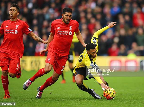 Etienne Capoue of Watford is challenged by Emre Can of Liverpool during the Barclays Premier League match between Watford and Liverpool at Vicarage...