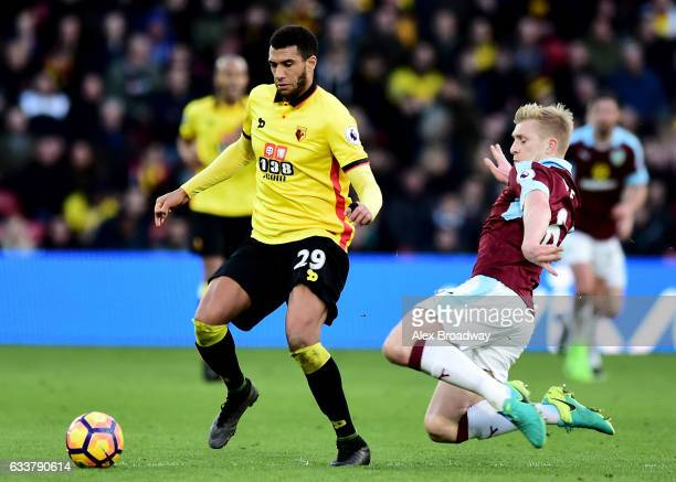 Etienne Capoue of Watford is tackled by Ben Mee of Burnley during the Premier League match between Watford and Burnley at Vicarage Road on February 4...
