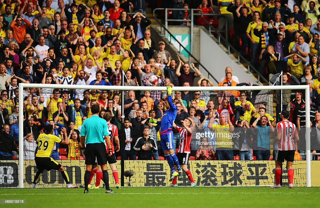 Etienne Capoue (L) of Watford reacts after failing to score from close range during the Barclays Premier League match between Watford and Southampton at Vicarage Road on August 23, 2015 in Watford, England.