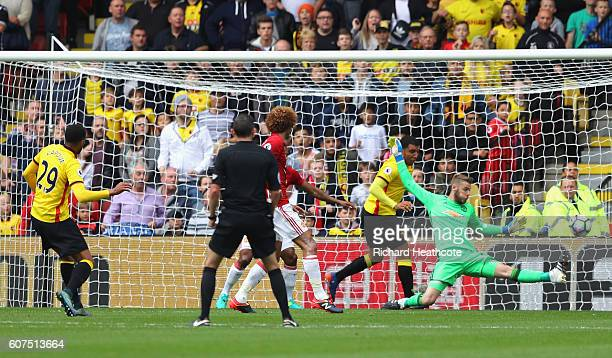 Etienne Capoue of Watford scores his sides first goal during the Premier League match between Watford and Manchester United at Vicarage Road on...