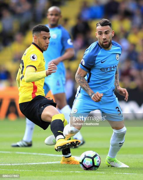 Etienne Capoue of Watford tackles Nicolas Otamendi of Manchester City during the Premier League match between Watford and Manchester City at Vicarage...