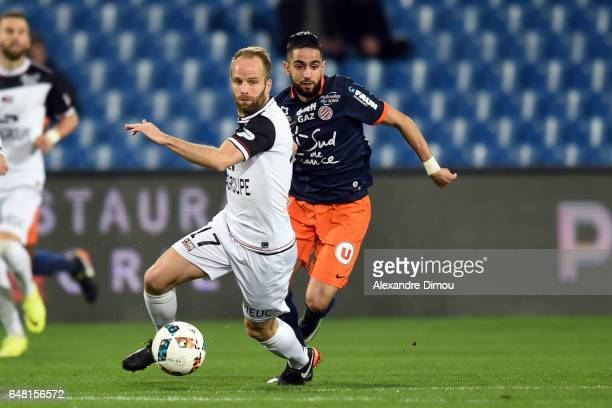 Etienne Didot of Guingamp and Ryad Boudebouz of Montpellier during the French Ligue 1 match between Montpellier and Guingamp at Stade de la Mosson on...