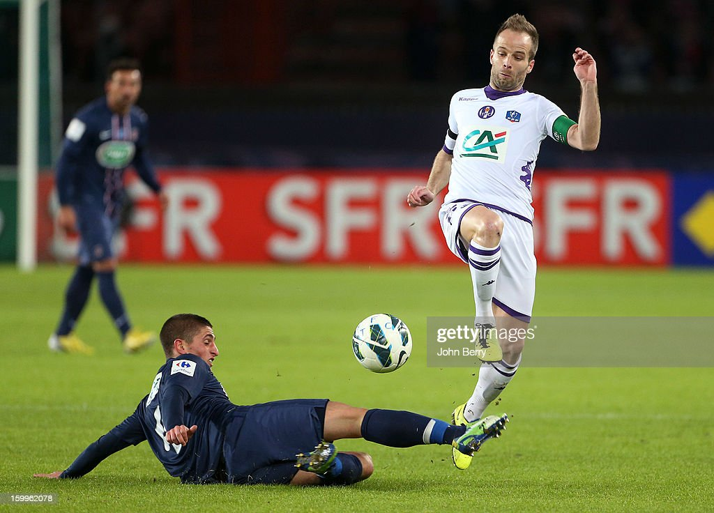 Etienne Didot of Toulouse (R) is challenged by Marco Verratti of PSG during the French Cup match between Paris Saint Germain FC and Toulouse FC at the Parc des Princes stadium on January 23, 2013 in Paris, France.