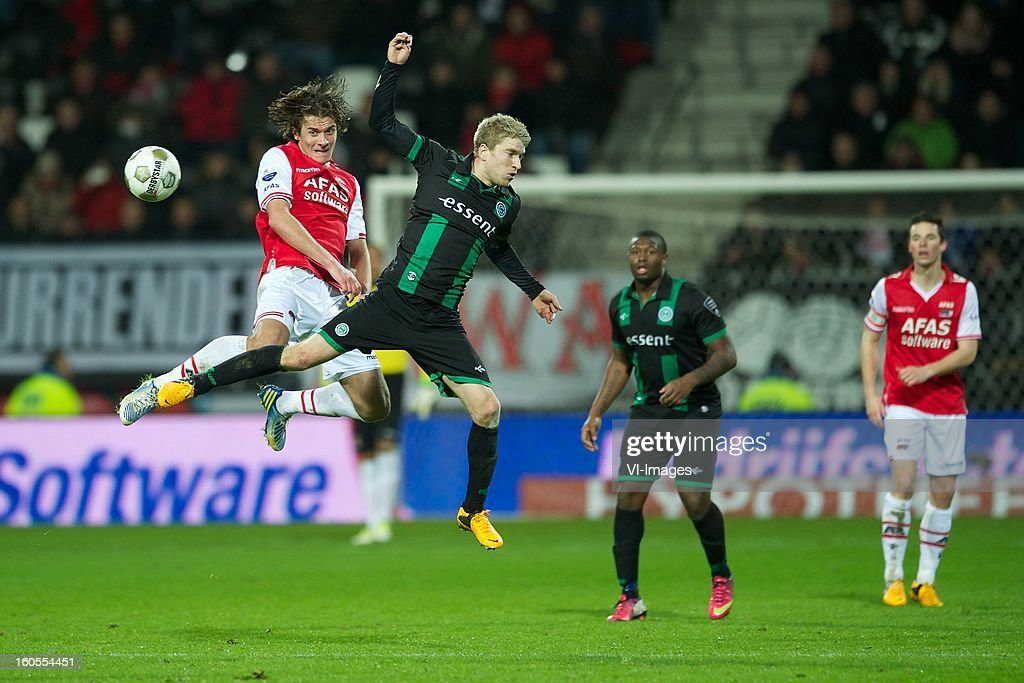Etienne Reijnen of AZ, Michael de Leeuw of FC Groningen during the Dutch Eredivisie match between AZ Alkmaar and FC Groningen at the AFAS Stadium on february 2, 2013 in Alkmaar, The Netherlands