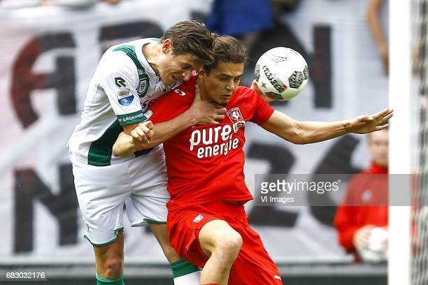 Etienne Reijnen of FC Groningen Enes Unal of FC Twenteduring the Dutch Eredivisie match between FC Twente and FC Groningen at the Grolsch Veste on...
