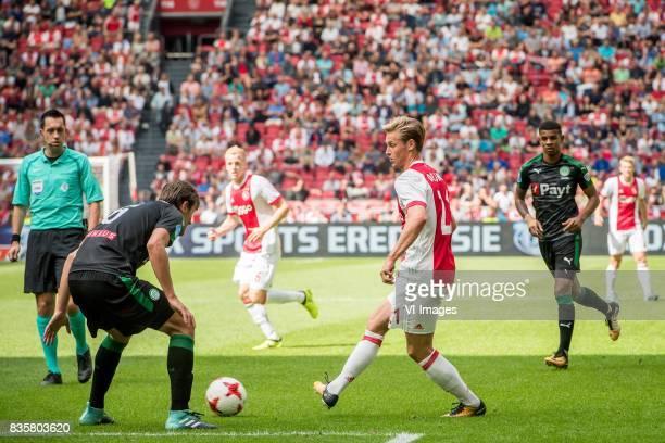 Etienne Reijnen of FC Groningen Frenkie de Jong of Ajax during the Dutch Eredivisie match between Ajax Amsterdam and FC Groningen at the Amsterdam...