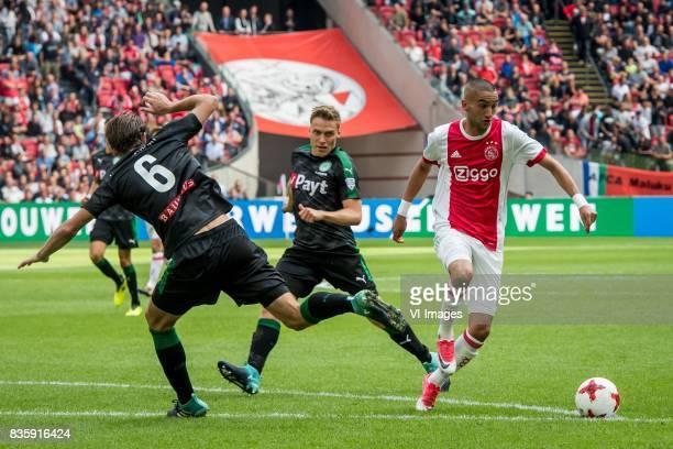 Etienne Reijnen of FC Groningen Ruben Yttergard Jenssen of FC Groningen Klaas Jan Huntelaar of Ajax during the Dutch Eredivisie match between Ajax...