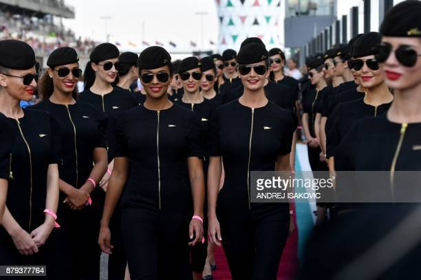 Etihad Airways' cabin crew members pose ahead of the Abu Dhabi Formula One Grand Prix at the Yas Marina circuit on November 26 2017 / AFP PHOTO /...