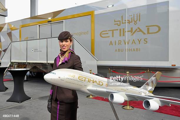 Etihad Airways stewardess poses next to a plane model during the Zurich Film Festival on September 28 2015 in Zurich Switzerland The 11th Zurich Film...
