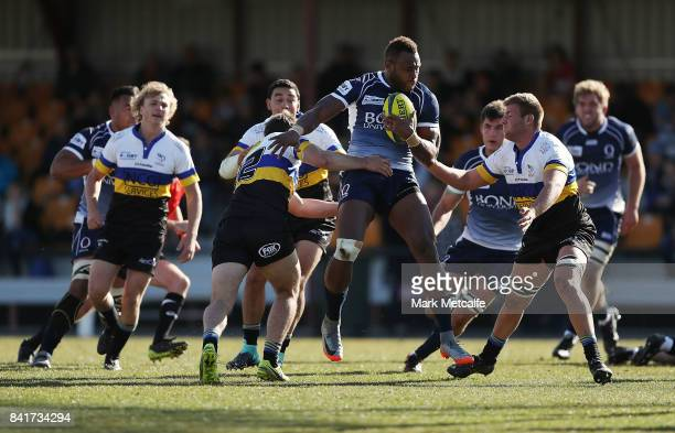 Eto Nabuli of Queensland Country is tackled during the round one NRC match between Canberra and Queensland Country at Viking Park on September 2 2017...