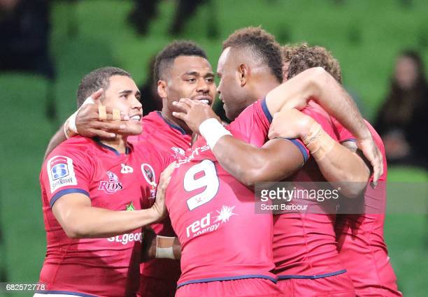 Eto Nabuli of the Reds is congratulated by his teammates after scoring a try during the round 12 Super Rugby match between the Melbourne Rebels and...