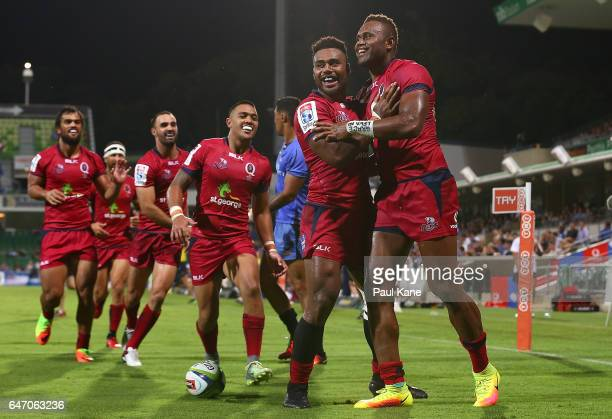 Eto Nabuli of the Reds is congratulated by Samu Kerevi after crossing for a try during the round two Super Rugby match between the Western Force and...