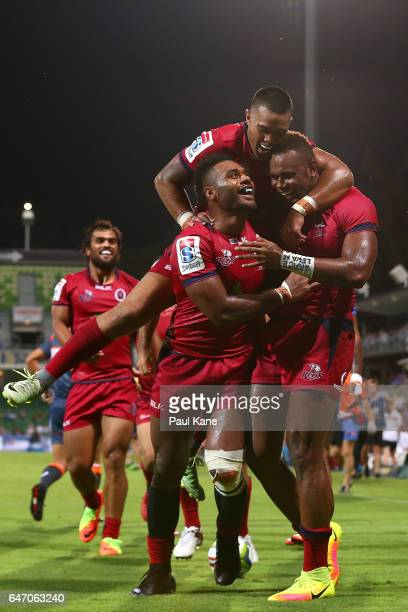 Eto Nabuli of the Reds is congratulated by Samu Kerevi and Duncan Paia'aua after crossing for a try during the round two Super Rugby match between...