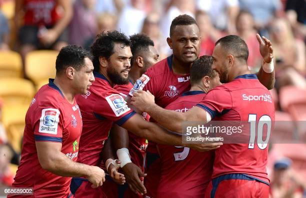 Eto Nabuli of the Reds is congratulated by team mates after scoring a try during the round eight Super Rugby match between the Reds and the Kings at...